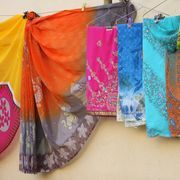 A sari-wrap skirt is a double layer skirt made of two half circles of Asian style fabric. Look for lightweight silk or cotton sari fabrics or any fabric with an Asian look and a soft drape. Saris or sarongs are large enough, generally drape well and come in beautiful colors and patterns. You don't need a pattern as you will construct your own out...