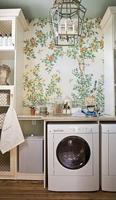Because why shouldn't your laundry room be wallpapered? This Gracie wallpaper brings a happy pop of pattern along with the fresh feeling of the outdoors into this laundry room.