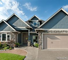 Cultured Stone Suede Limestone residential house exterior garage project view