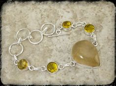 'Pretty Citrine and Yellow Quartz Bracelet'  $15.00 Message me here if interested :)