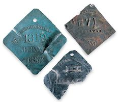 Read about slave badges used during American Slavery.