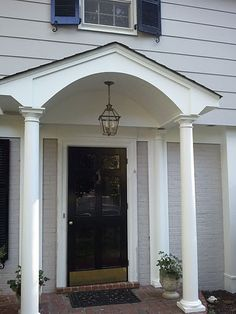 I like the arch, round columns and single hanging light fixture.