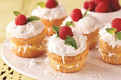 Coconut Cream Cupcakes recipe - If you're the competitive type, bring these raspberry-and-mint-topped Coconut Cream Cupcakes to the bake sale. Yours will go first. Triumph!