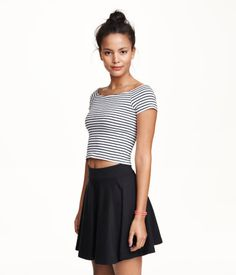 Short circle skirt in stretch jersey with wide elastication at waist. Unlined.