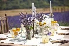 Idea for some of the tables center pieces,  I have the glass flower bottles, will use some lavender some daisy, some baby breath, etc.,