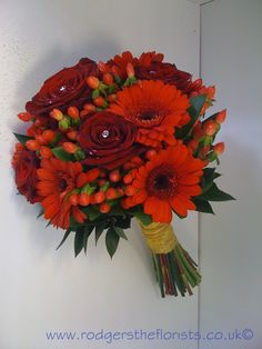 Orange and red hand tied #wedding bouquet posy. We would love to create a bespoke wedding bouquet in your wedding colours, find us at www.rodgerstheflorists.co.uk