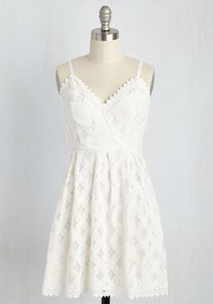 Shore hopping in this ivory sundress is what warm weather is all about! By flaunting the diamond-patterned lace, scalloped trim, and silver exposed zipper of this airy A-line frock, you look and feel like the poster child of coastal charm.
