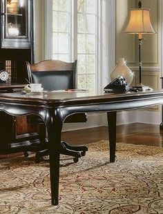 Historic detailing and modern amenities meet in the handsome Renee Writing Desk that boasts outlets for power, phone and data and a solid hardwood frame finished in rich cherry.