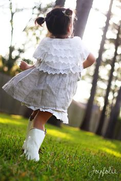 Ruffle Cape from the back along the white patten leather boots...now this is precious!