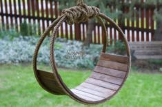 "I don't know why we didn't make this hammock a few years ago when we first introduced the hammocks and dream catchers! I love the simple, rustic design. It's hand cut slats, secured tightly to the wood hoops. I've then stained it to a dark earth tone and finished it off by attaching rustic, barn rope. Simply Beautiful! Dream Catcher is approximately 18"" wide X 10"" deepBeautiful image by Ali Russell-Live, Laugh"
