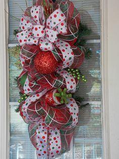 Christmas Deco Mesh Swag with Ornaments, Polk A Dot Ribbon, and Bow. $55.00, via Etsy.