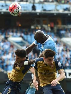 Eliaquim Mangala outjumps Gabriel and Hector Bellerin
