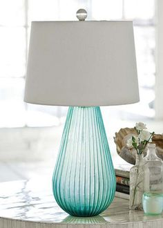 """Beautiful sea blues and the 25""""T Aqua Spa Art Glass lamp is the perfect complement to coastal living decor!"""