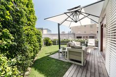 http://sandavy.com/attractive-spacious-cap-dail-apartment-combining-elegance-and-functionality-concept-design/glass-table-comfy-sofa-cushions-fresh-backyard-grass-canopies-exterior-design-white-lounge-chairs-green-nature-tree-white-sofa-green-grass-white-roof-relaxing-place-family-white-cushion-2-drink-glass/