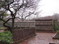 """""""View of Bonnefont Cloister herb garden in early winter. The hurdles around the quince trees at the center of the garden remain in place all year, providing winter interest. The wattle plant supports are generally removed after the growing season."""" Photo by the author, Christina Alphonso, Administrator, The Cloisters (NYC). Via The Cloisters' In Season blog."""