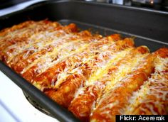***Red enchiladas with freezing instruction - Splendid table - sub roasted veg for chicken: 1 small zucchini, 1 small yellow squash, 2 med onions, 2 poblanos, 8oz creminis - roast and peel poblanos; caramelize onions; roast other veg in 425 oven, mushrooms approx 20min, squash approx 30 min - mix only with cheese and fill shells