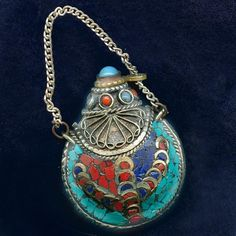 Silver snuff bottle with coral, lapis and turquoise inlay from Nepal