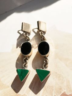 Vintage shape earrings that make a big statement - triangular malachite stones, oval onyx stones and square sterling pieces make up these dangle earrings. These are as versatile as they are fun.  HISTORY: More modern vintage, 1990s or 1980s. Mexican made.  MATERIALS: Sterling silver, onyx, malachite  SIZE: These measure 2 1/4 in length. The square and oval are 3/8 across; the triangle measures 7/16 at its widest point.  CONDITION: Great condition! The one onyx stone does have a...
