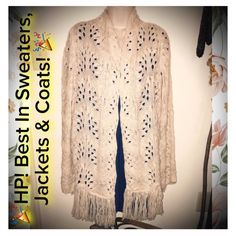 HPVINTAGE CROCHETED FRINGE SHAW CARDIGAN SWEATER Beautiful! Vintage Ivory shaw that is one size fits all. This is a beautiful crocheted shaw styled cardigan sweater and is very warm! Longer length as shown would look great over a dress or with a pair of jeans! This item is in excellent pre wonder condition! Bundle & save! Follow my closet new items added daily. I follow posh rules! Please, NO TRADES & NO OUTSIDE TRANSACTIONS! Happy POSHING loves!  Sweaters Cardigans