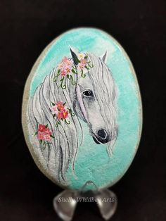 This stone is hand painted with love and care with acrylic paints. The stone is sealed for its protection. Not recommended for outdoors. Dimensions 5.25x3.75