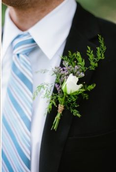 Men can wear black coat, black pants, black vest with white shirt and blue/ white stripped tie as shown here but no pink in it . Can have white or matching blue handkerchief. Then have Pale Peach Rose boutonniere pictured in another pin. groomsmen can have and light blue Hydrangea boutonniere.