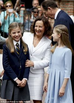 Princess Leonor and Princess Sofia posed with Queen Letizia's mother Paloma Rocasolano attend the First Communion
