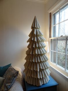 DIY book page Christmas tree,  not sure if I could tear up a book but this is really neat
