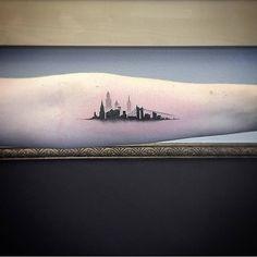 Single needle New York skyline tattoo on the left inner forearm. Tattoo artist: East