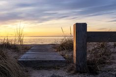 Long Island Sound at sunset. I chose the low angle because sunlight was hitting the surface of the post. _MG_2329Es.jpg