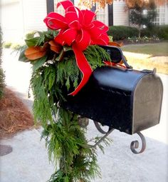 10 hotspots for holiday decor The Mailbox Bright ribbons, twinkling lights and garland all create a warm welcome for visitors and your mail carrier.