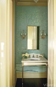 Hand-painted wallpaper classicly enriches a Greenwich, Connecticut powder room. Sink and faucet, both Sherle Wagner. Mirror, Fred Reed Picture Framing. Custom wallpaper, De Gournay. Image originally appeared in the January/February 2011 issue of VERANDA.