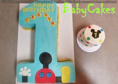 Mickey Mouse themed 1st Birthday cake with coordinating smash cake.