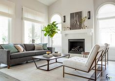 a-fascinating-living-room-with-arched-windows-and-modern-firepit-plus-indoor-potted-plant-decor-enhanced-with-grey-sofa-nad-simply-wooden-table-and-chairs.jpg (1048×741)