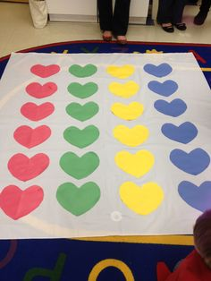 Valentine's Day Game, Twister. White shower curtain, colored hearts.
