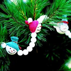 """Snowman Christmas Tree Garland - Not sure about all the work involved in making the snowmen (cutting infant socks...I don't have any of those! LOL) but I like the idea of the garland in general.  Good """"in front of the TV"""" kind of project."""