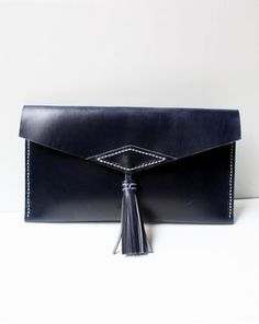 Clutch bolso de mano de cuero azul – Follow the Folk
