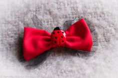 Red and black bow with ladybug button hair clip / barrette on Etsy, $4.00 CAD