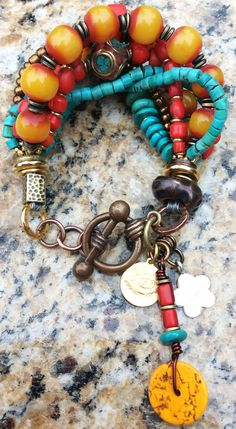 Kathmandu Charm Bracelet: Tibetan-Inspired Turquoise, Yellow, Red and Bronze Charm Bracelet $175