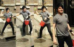 Adam Lambert playing with water balloons