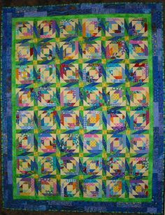 """Quilt for Micah Joy by nancycarol  Block is """"Pineapple Blossom"""" from www.quiltville.com with pieced sashing. Totally scrappy. Hand and machine quilted."""