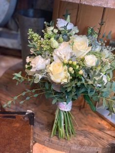 Blended ivory bouquet including roses, lilac, eucalyptus and lissianthus all help create a wonderful natural feeling to Zena's bridal bouquet