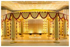 Witness Varnamala's obsession! Obsession with decor and flowers. Who doesn't get blown away, walking up on a floral aisle, or to see… - Moyiki Sites Reception Stage Decor, Wedding Stage Backdrop, Wedding Stage Design, Wedding Hall Decorations, Marriage Decoration, Tent Decorations, Wedding Mandap, Wedding Ceremony Backdrop, Traditional Wedding Decor