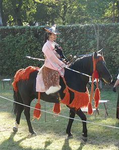 Yabusame (Horseback archery) Shinto ritual of Japan. Kamakura era costume.