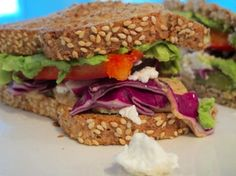 Ezekiel Sesame Bread Sandwich with cabbage, red pepper, avocado, pickles, mustard, romaine and feta cheese