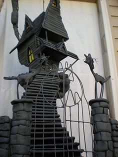 custom haunted house models. You send a pic, he makes a model of your house or whereever, only, 'haunted.' SO COOL.