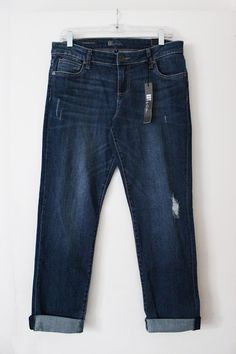 Kut from the Kloth Kate Distressed Boyfriend Jeans. Dark wash, lightly distressed, and the perfect rolled cuff. Great construction and perfect price. Stitch Fix