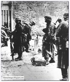Tough battle-hardened Waffen SS soldiers at Kharkov. 1943. They were by now fighting a losing war.