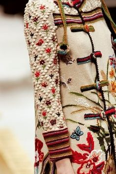 I think I spy crocheted sleeve cuffs - single crochet in the round, or possibly Bosnian. Knitted coat with embroidery. Mode Russe, Mode Kimono, Fashion Bubbles, Mode Boho, Knitted Coat, Mode Inspiration, Fashion Details, Wearable Art, Boho Chic