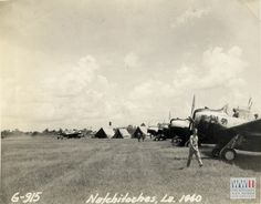 Airfield in Louisiana field, observation aircraft in foreground and water towers in background at Natchitoches, Louisiana in 1940. Gift in Memory of John O. Spinks, Sr. from The Digital Collections of the National WWII Museum. 2011.018.004.