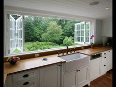 This open up full view kitchen window with full view of the back yard seems like a great idea for watching the kids. I could see something similar for different settings as well like a view of the mountains...